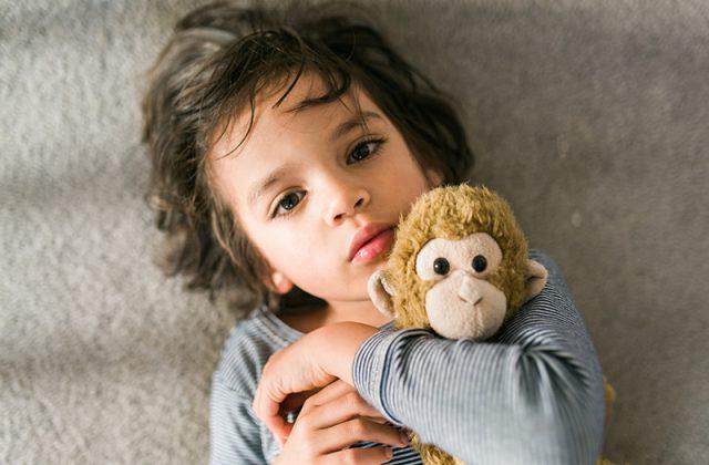 young boy and stuffed animal